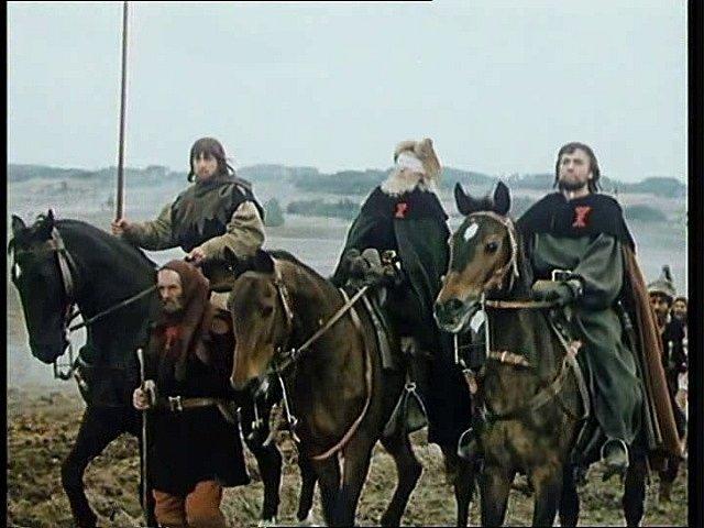 Husitští kněží jedou krajinou u Svéradic v čele zástupu a přivádějí na horu Tábor další přívržence.