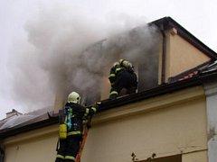Požár v podkroví rodinného domu v Modřicích