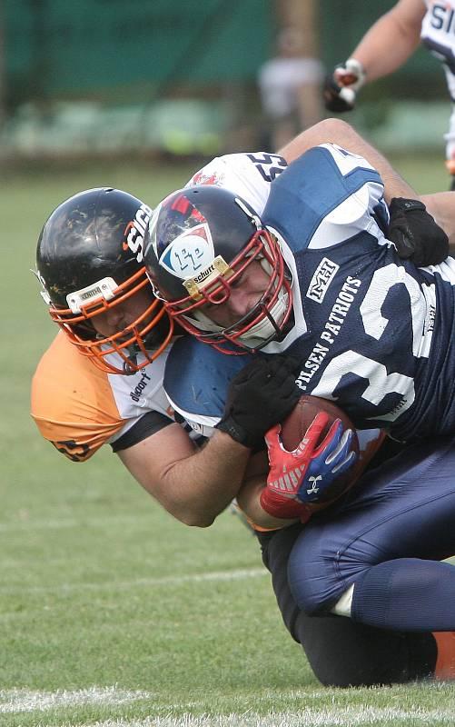 Šampionem druhé ligy amerického fotbalu se po vítězství 67:0 nad Plzní stali hráči Brno Sígrs.