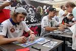 Karel Hanika, Karel Abraham a Jakub Kornfeil při podepisování na autogramiádě jezdců Moto GP v brněnské Vaňkovce.