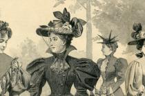 Historické klobouky na dobovém snímku.
