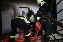 Požár domu Diecézní charity Brno v Žižkově ulici. Hasiči evakuovali 25 starších lidí.