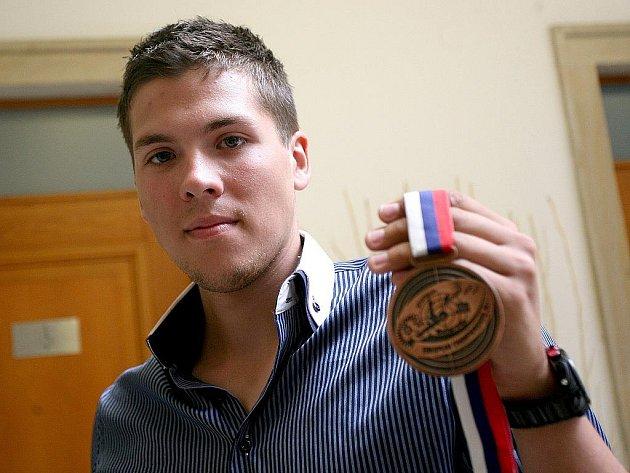 Brokový střelec brněnské komety Jakub Tomeček.