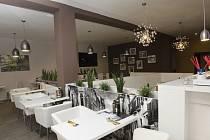 Restaurace l'Abbuffata láká hosty na italská jídla.
