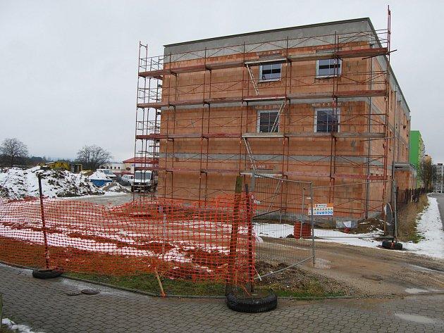 Obchodně bytový komplex u kterého by mohlo vzniknout Malé náměstí