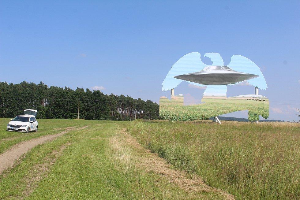 Reklamní orel s motivem přistávajícího UFO.