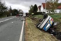 Nehoda policejního vozu s traktorem u Holostřev