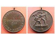 Rub a líc nalezené medaile.
