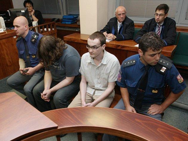 Dva bývalé skautské vedoucí z Ústí v pátek krajský soud odsoudil k desetiletému vězení.