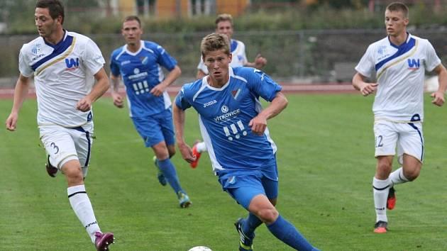 Ústečtí fotbalisté (bílí) doma porazili Baník Ostrava 2:0 a postoupili do osmifinále poháru.