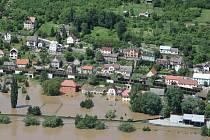 Plán ministerstva pro místní rozvoj by se dotkl například lidí z Dolních Zálezel, kterým povodeň zaplavila domy v červnu loňského roku.