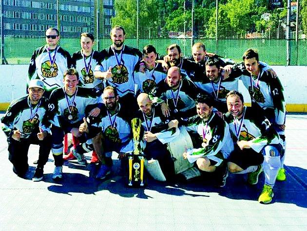 Hokejbalisté Comy.