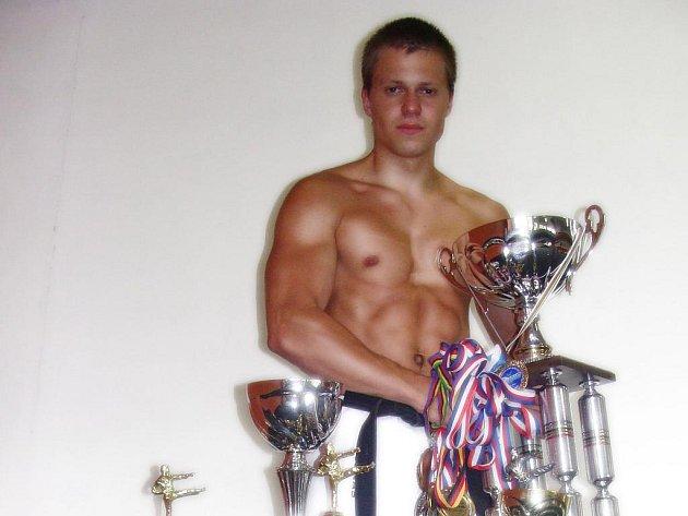 Jonáš Petřík se svými trofejemi