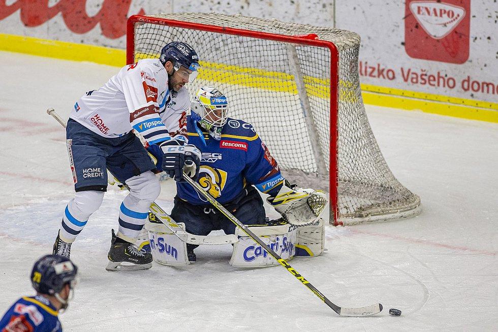Hokejisté Zlína (v modrém) v úterý večer na Zimním stadionu Luďka Čajky vyzvali Bílé Tygry z Liberce. Na snímku Huf Foto: pro Deník/Jiří Zaňát