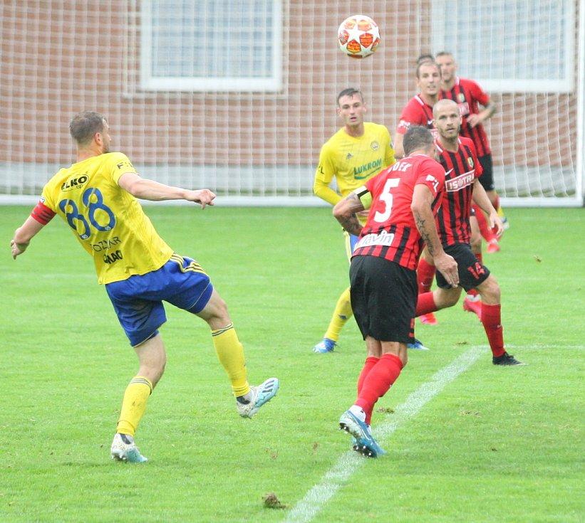 Fotbalisté Fastavu Zlín (ve žlutém) v úvodním kole Fortunba:ligy skupiny o záchranu hostili Slerzský FC Opava.