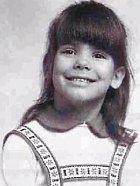 V pěti už měla svůj typický úsměv a bradičku.