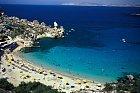 Písek na pláži Paradise je na ostrovech světlou výjimkou.