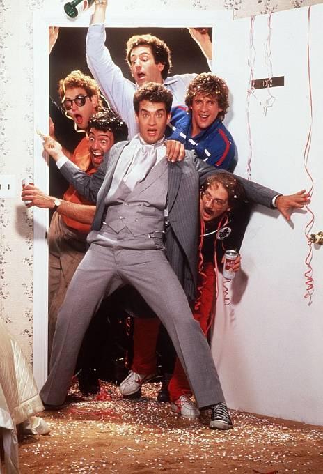 Komedia Pánská jízda (1984). Michael je vpravo v modrém tričku za Tomem Hanksem.