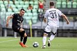 Utkání 1. kola fotbalové Fortuna ligy: MFK Karviná - FC Baník Ostrava, 23. srpna 2020 v Karviné. Rudolf Reiter z Ostravy a Lukáš Bartošák z Karviné.