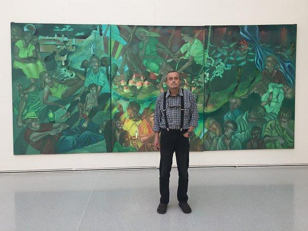 MARTIN PAWERA u jednoho ze svých děl na současné výstavě v pražském Mánesu. Foto: