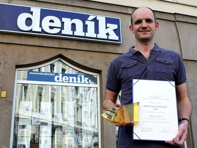 Martin Pleva s první cenou z patnáctého ročníku soutěže Média na pomoc památkám.