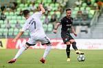 Utkání 1. kola fotbalové Fortuna ligy: MFK Karviná - FC Baník Ostrava, 23. srpna 2020 v Karviné. Tomáš Ostrák z Karviné a Daniel Holzer z Ostravy.