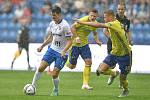 Utkání 2. kola první fotbalové ligy Fastav Zlín (ve žlutém) na půdě ostravského Baníki nezvládl, padl vysoko 1:5. Na snímku zleva ostravský David Buchta a Václav Procházka ze Zlína.