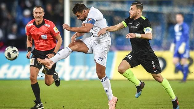 Utkání 21. kola první fotbalové ligy: FC Baník Ostrava - Slovan Liberec, 16. února 2019 v Ostravě. Na snímku Milan Baroš a Jan Mikula.