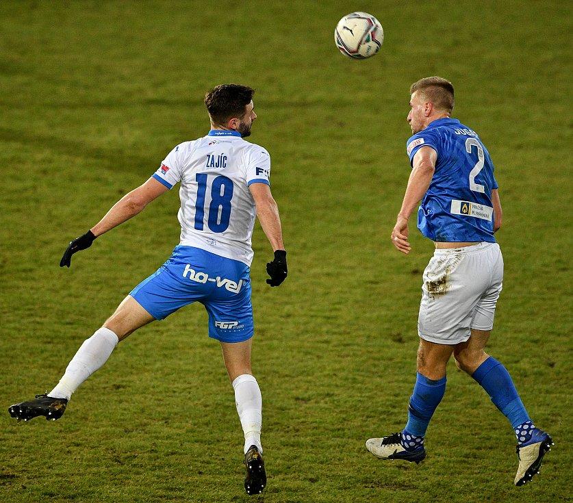 Utkání 9. kola první fotbalové ligy: Baník Ostrava - Slovan Liberec, 27. ledna 2021 v Ostravě. (zleva) Tomáš Zajíc z Ostravy a Jakub Jugas z Liberce.