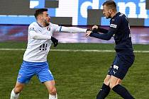 Utkání 8. kola první fotbalové ligy: FC Baník Ostrava - FC Slovácko, 20. ledna 2021 v Ostravě. (zleva) Tomáš Zajíc z Ostravy a Stanislav Hofmann ze Slovácka.