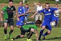 Před týdnem vyřadili fotbalisté Petřkovic Petrovice. Dnes je ale čeká jiný kalibr. Na domácím hřišti změří síly se Slezským FC Opava.
