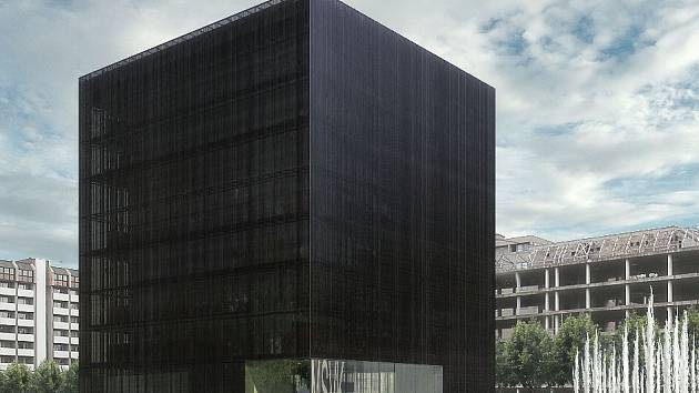 Tmavá průsvitná kostka měla podle autorů – brněnských architektů Ladislava Kuby a Tomáše Pilaře – symbolizovat pevnou schránku vědění společnosti.