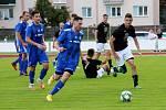 Fotbalisté Zábřehu (černé dresy) v nedělním utkání proti Rapotínu