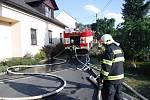 Požár rodinného domku a blízké louky v Hrabové