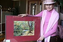 Květoslava Snášelová a jeden z jejich dřívějších obrazů. Ilustrační foto