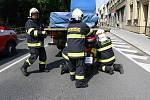 Nehoda skútru s náklaďákem na Vápenici