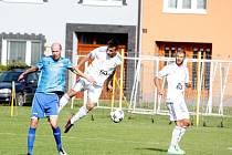 Určice proti Lískovci - Tomáš Los (vlevo)