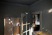 Následky požáru v bytě v ulici J.V. Myslbeka v Prostějově