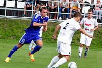 Fotbalisté 1.SK Prostějov (v modrém) proti HFK Olomouc
