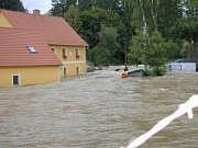 Nově rekonstruovaný dům vedle toku Malše.