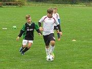 Oblastní I.A třída mladší žáci (skupina A)  - 3. kolo: FK Spartak Kaplice (černozelené dresy) - TJ Centropen Dačice + Třebětice 8:5 (5:3).