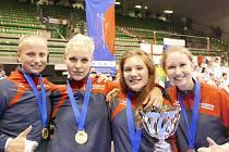 Historicky první zlatou medaili z mistrovství světa World Shotokan Karate-do Association pro Českou republiku vybojoval  kvartet juniorek ve složení Kristýna Bosáková, Alice Andrlová, Klára Kovářová a Natálie Hůrková (zcela vpravo).