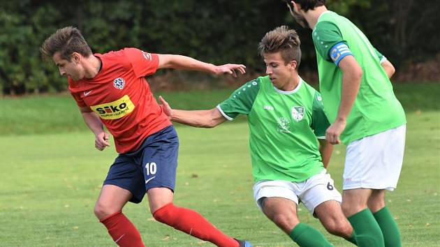 Ondrášovka KP muži - 7. kolo: Sico Čimelice (červené dresy) - FK Slavoj Český Krumlov 1:1 (1:0).