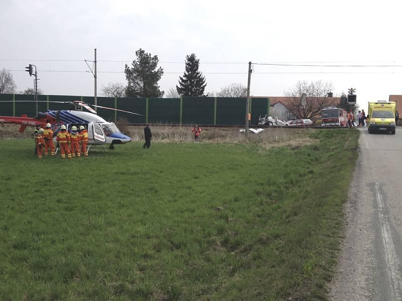 Srážka na železničním přejezdu v Holkově.