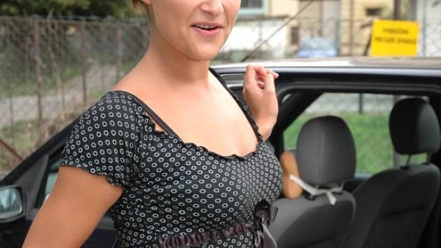 Alexandra Kallusová a její svatební šaty.