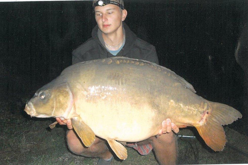 Soutěžní číslo 128 - Petr Smékal, kapr, 88 cm a 18 kg.