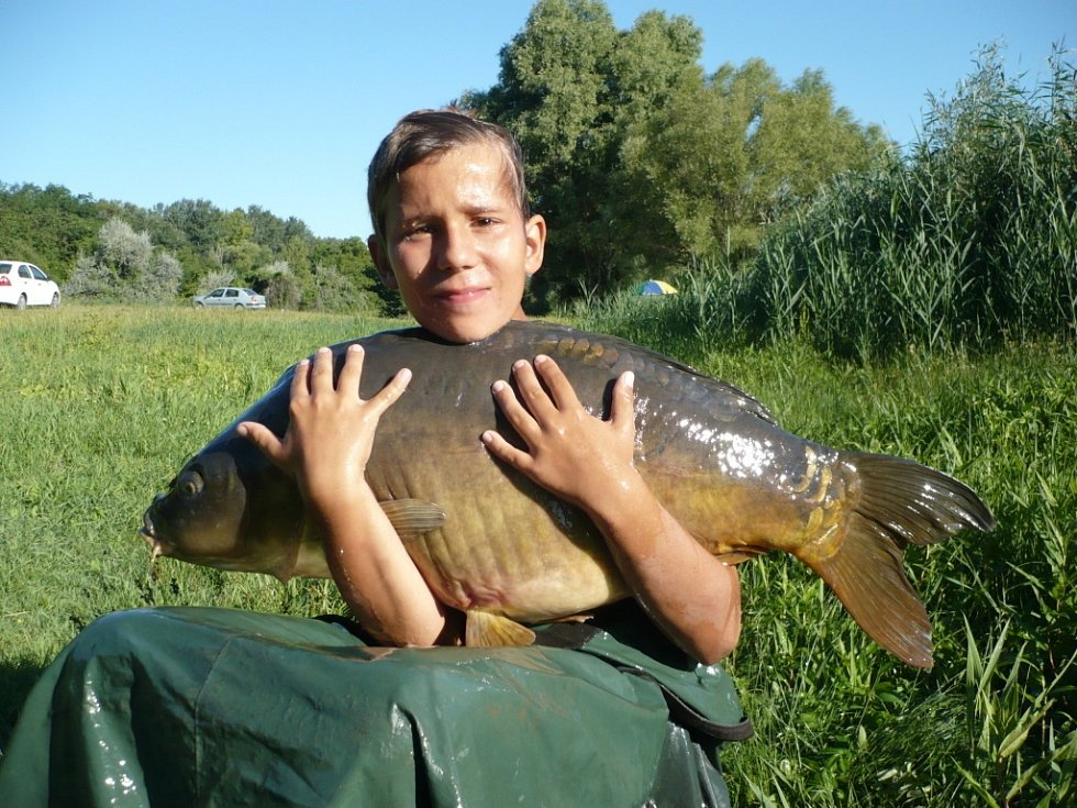 Soutěžní číslo 135 – Adam Pořízka, kapr, 91 cm, 18 kg.