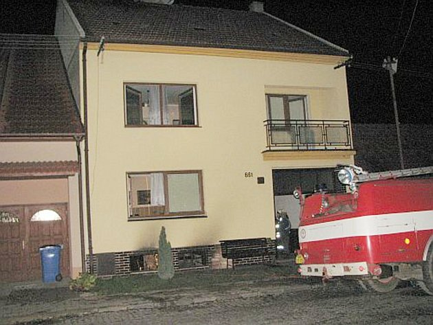 Požár v rodinném domě.