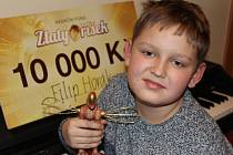 Filip Horák s cenami Zlatý oříšek.