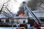 Požár dílny u areálu skateparku na ostrově Štvanice.